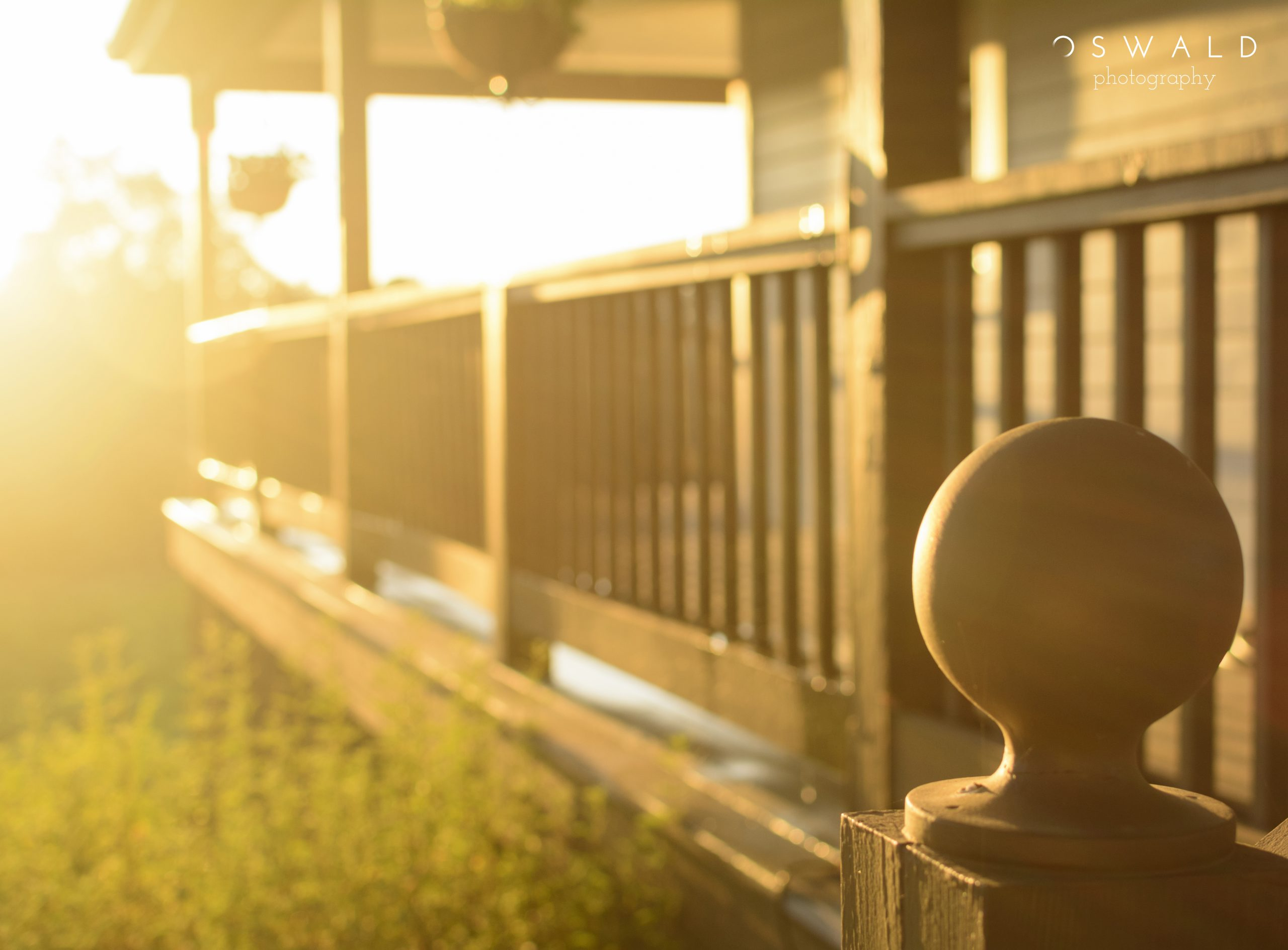 Photography of afternoon rays of sun against a wooden porch