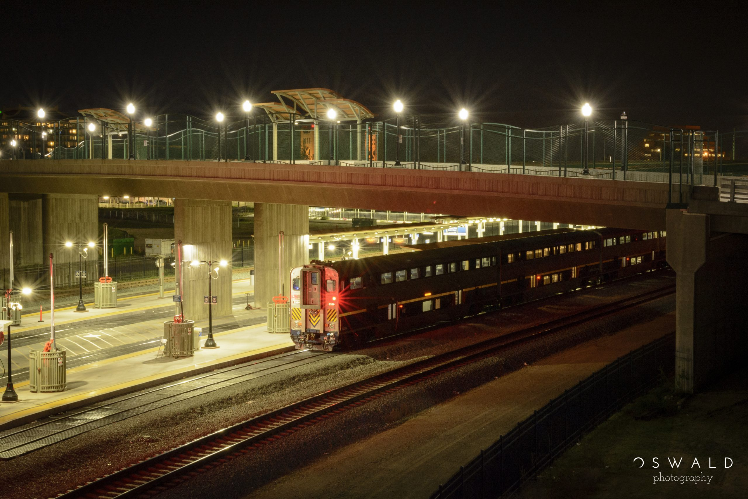 Photograph of a n train that has reached the platform for night, emptied of all of its passengers.