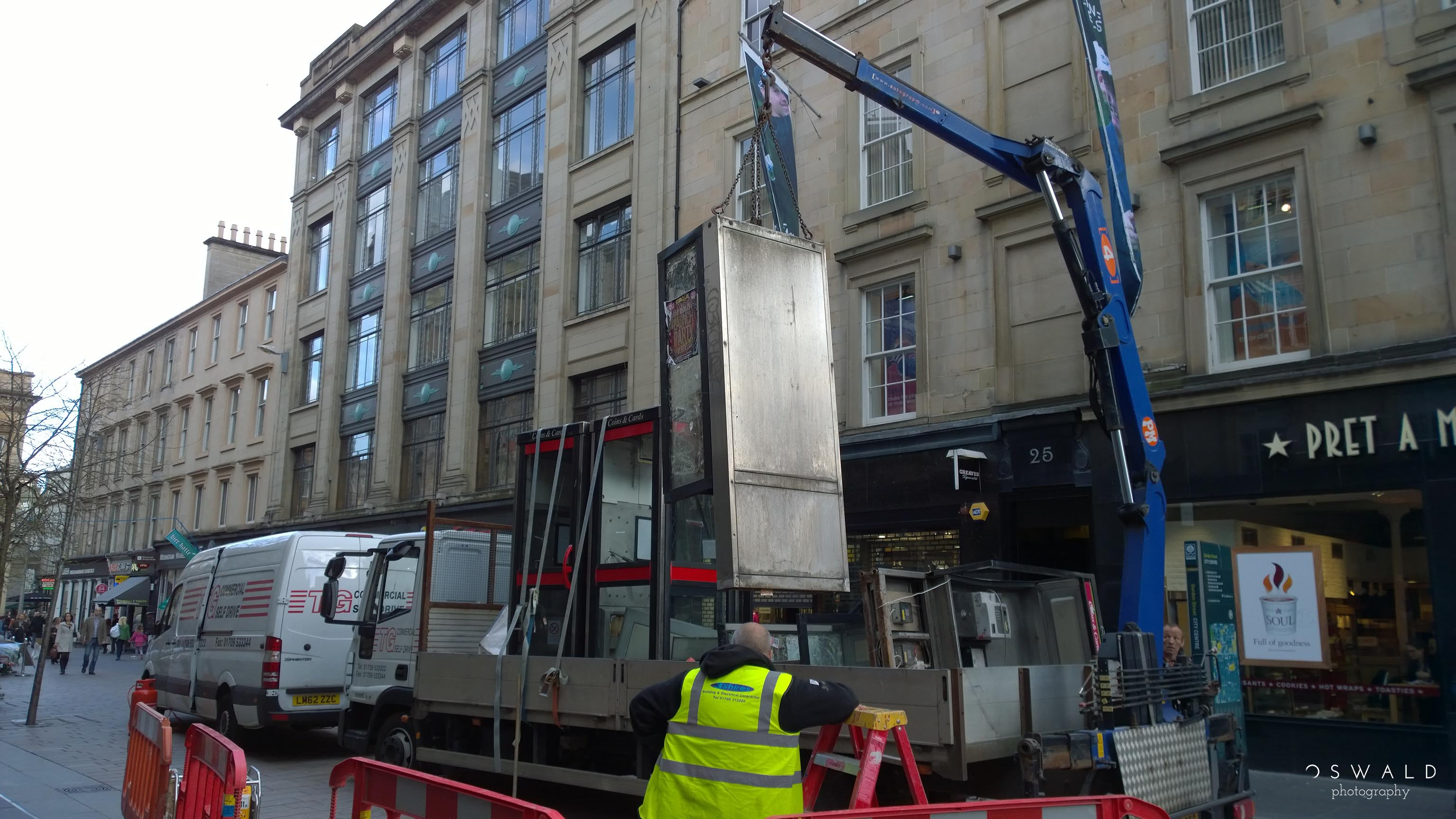 Photograph of a Glasgow phone booth being removed