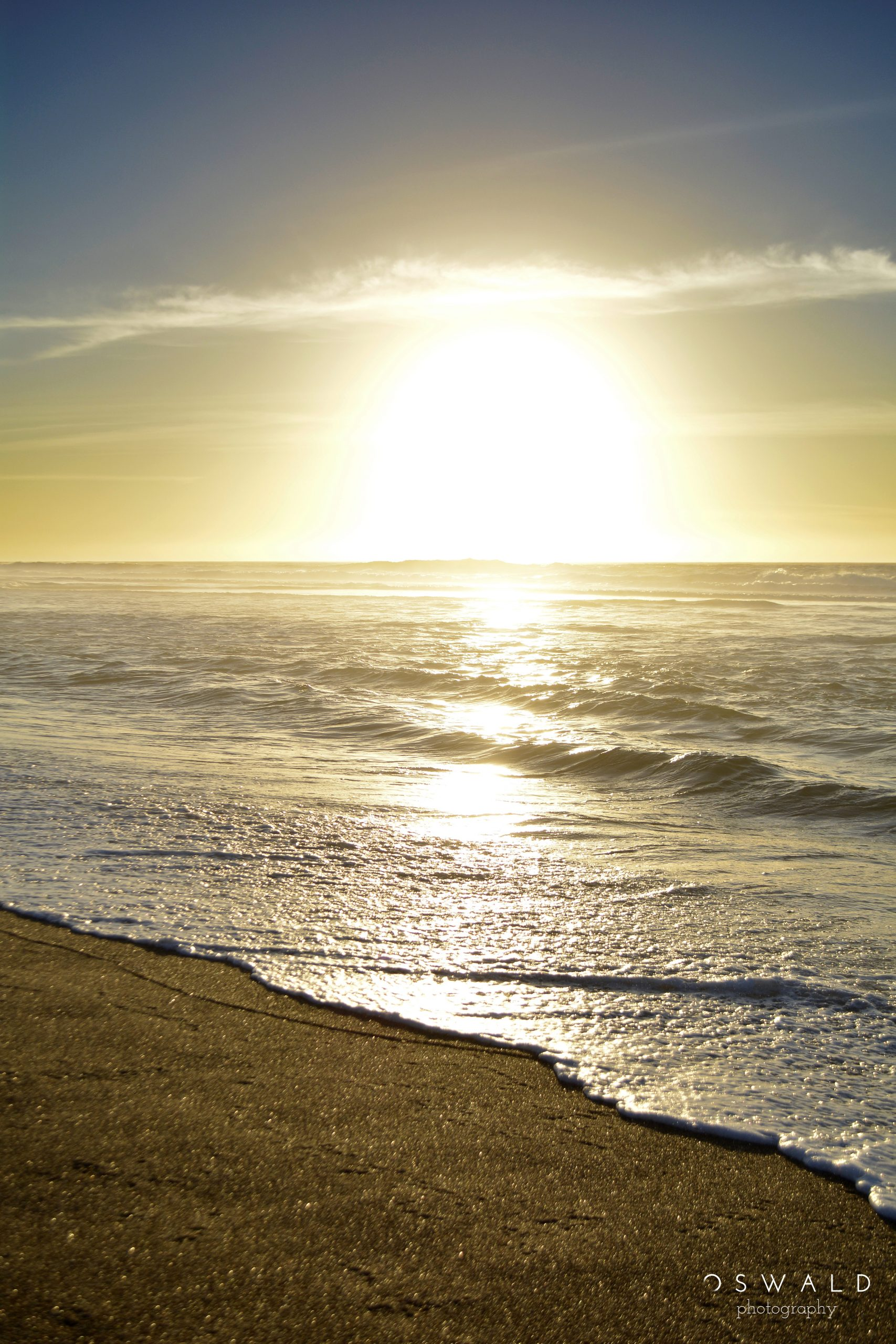 The sun sets behind the waves at Point Reyes National Seashore in Northern California.