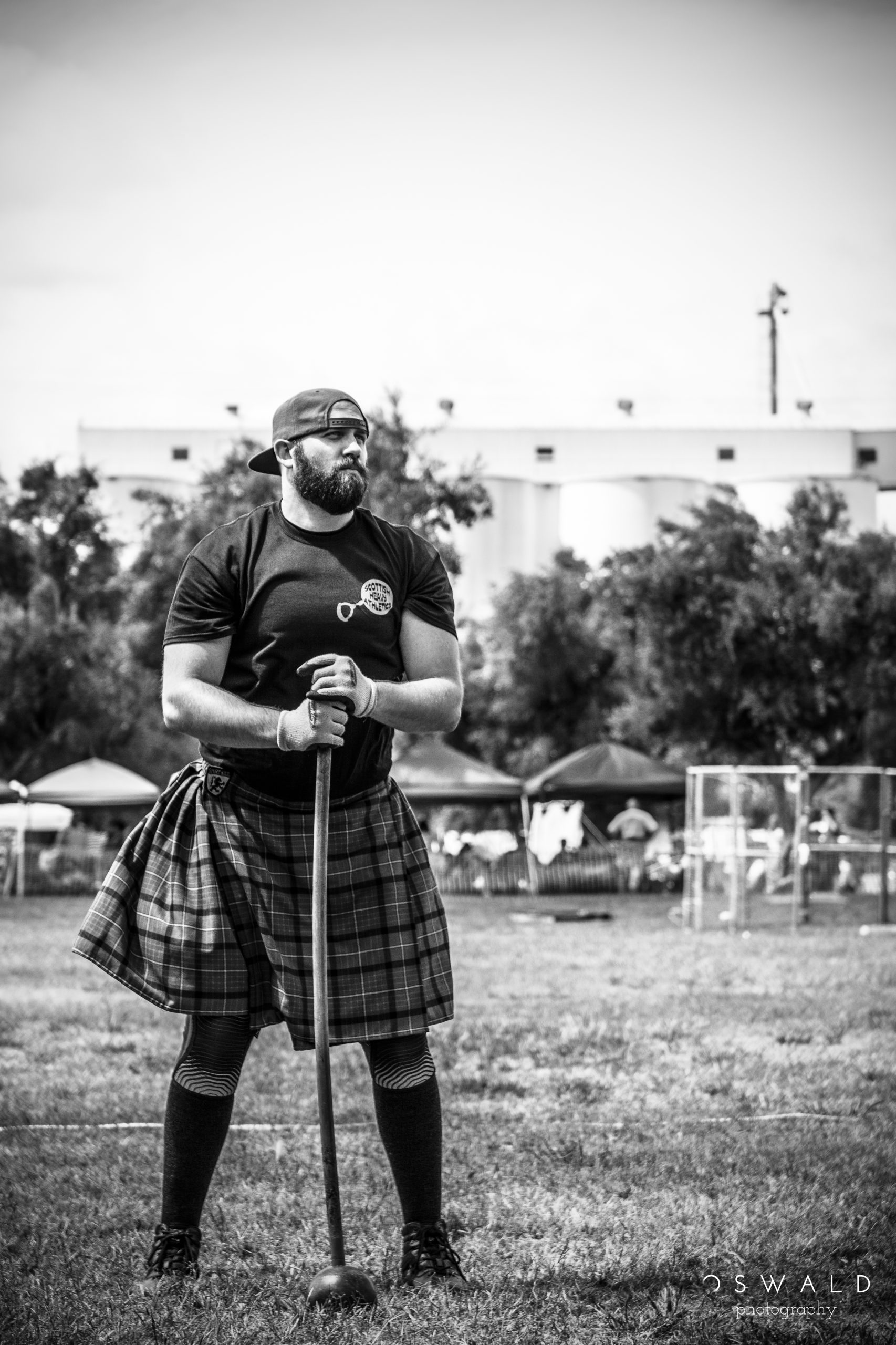 A strong and muscular young man stands at ease prior to his competition in the Scottish Hammer Toss.