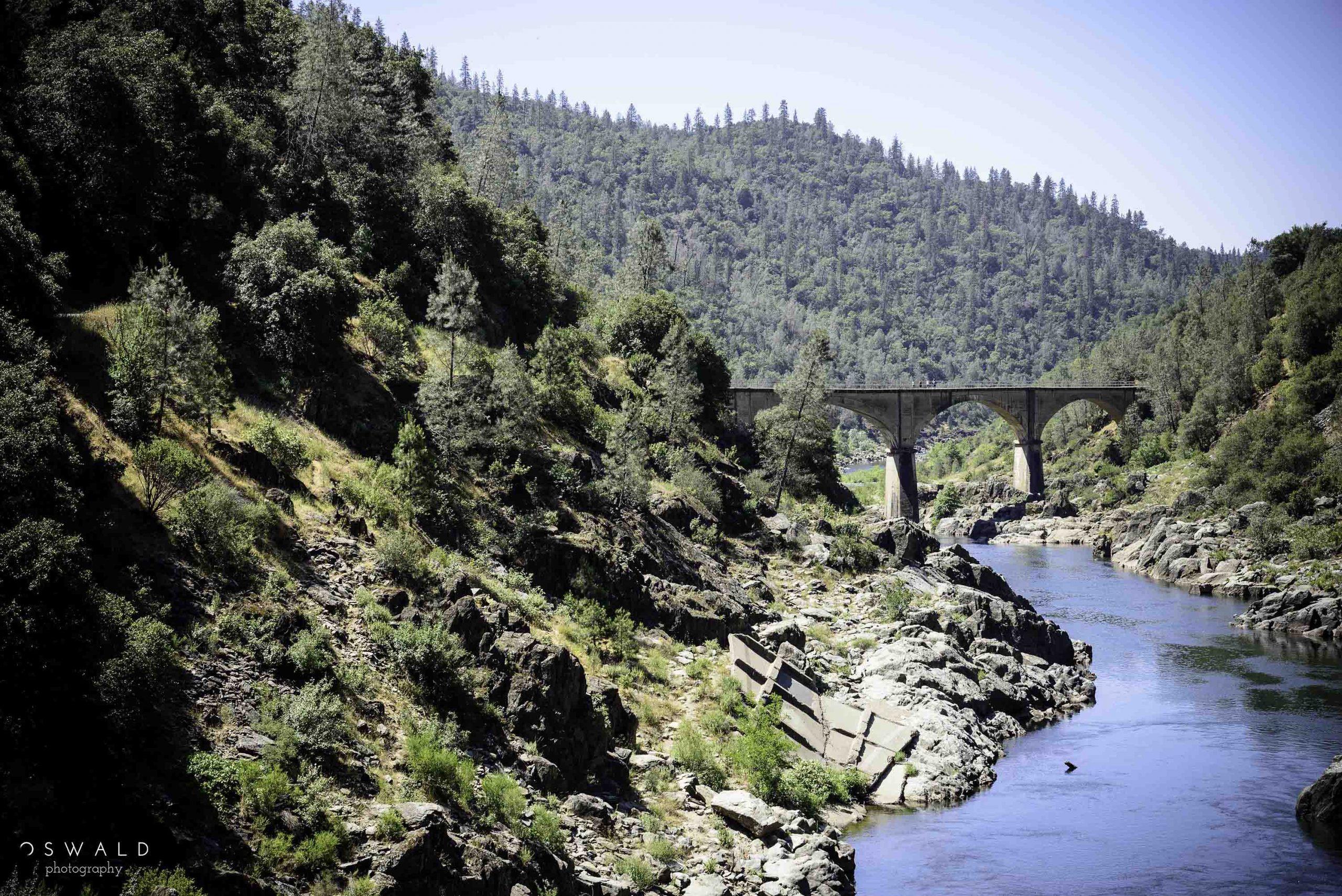Landscape photograph of an old stone footbridge at the Auburn State Recreation Area near Auburn in Northern California.