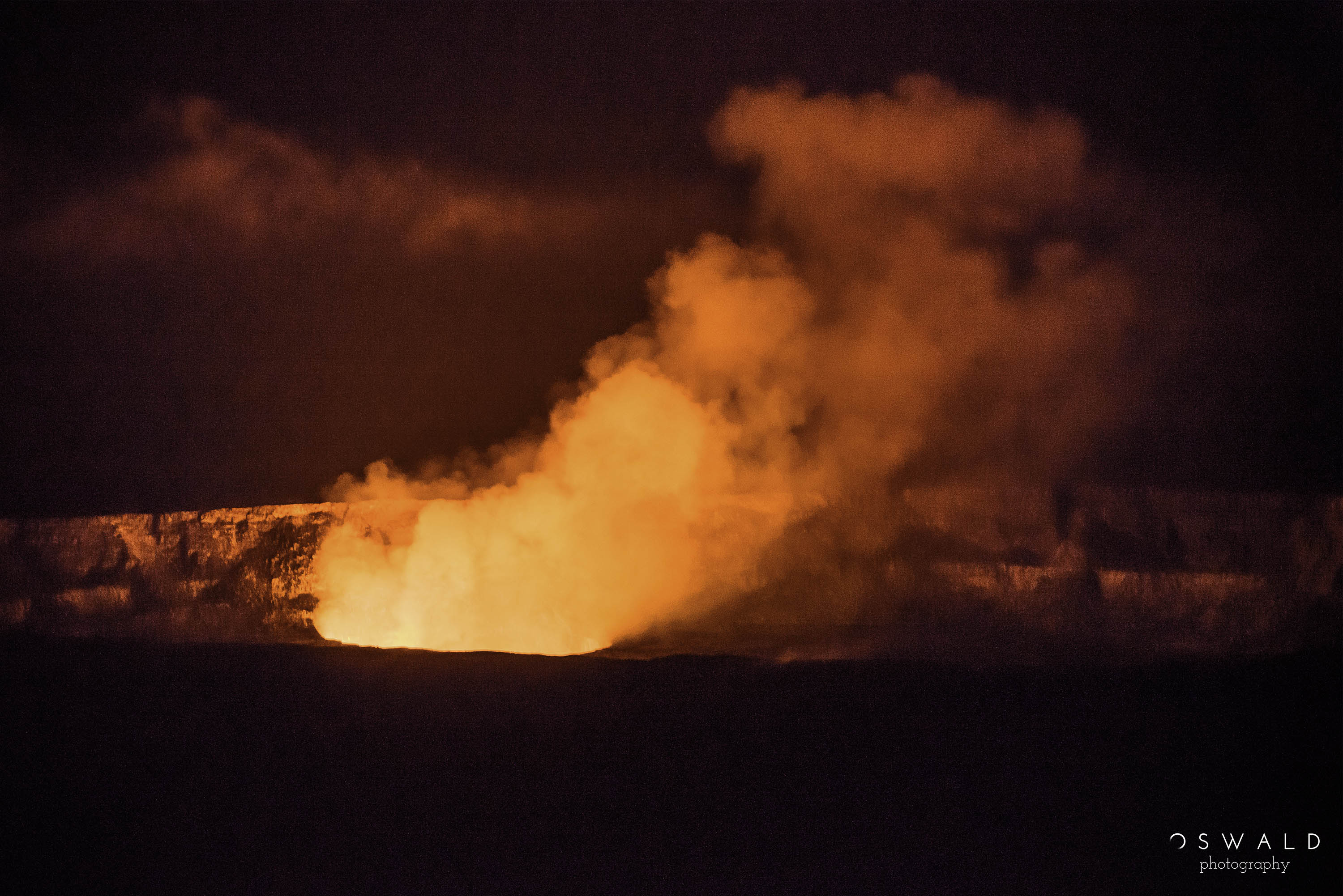 A nighttime photograph of the Kilauea Caldera from the Jaggar Museum at Hawaii Volcanoes National Park.