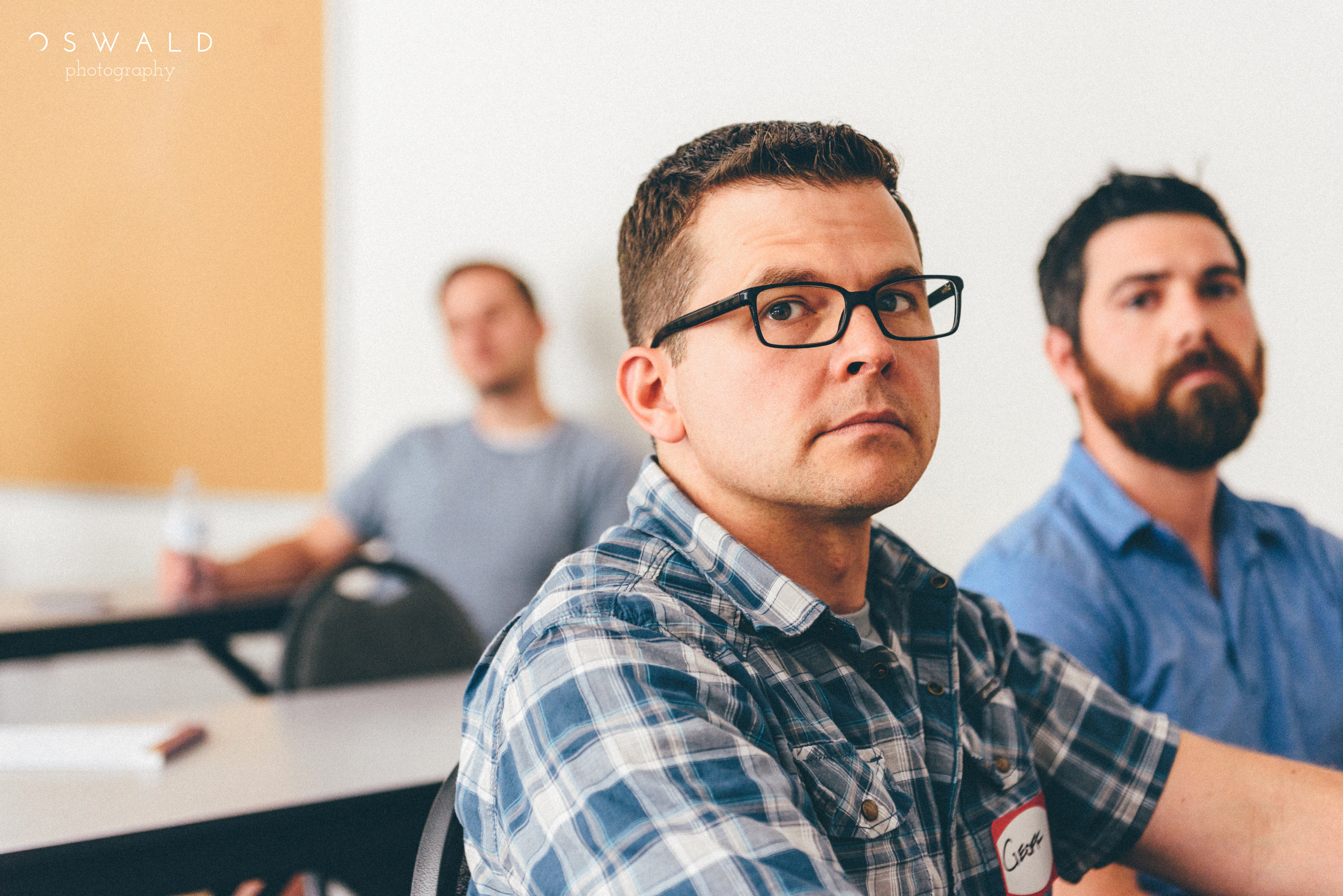 Photograph of three young seminary students in the classroom at Western Seminary.