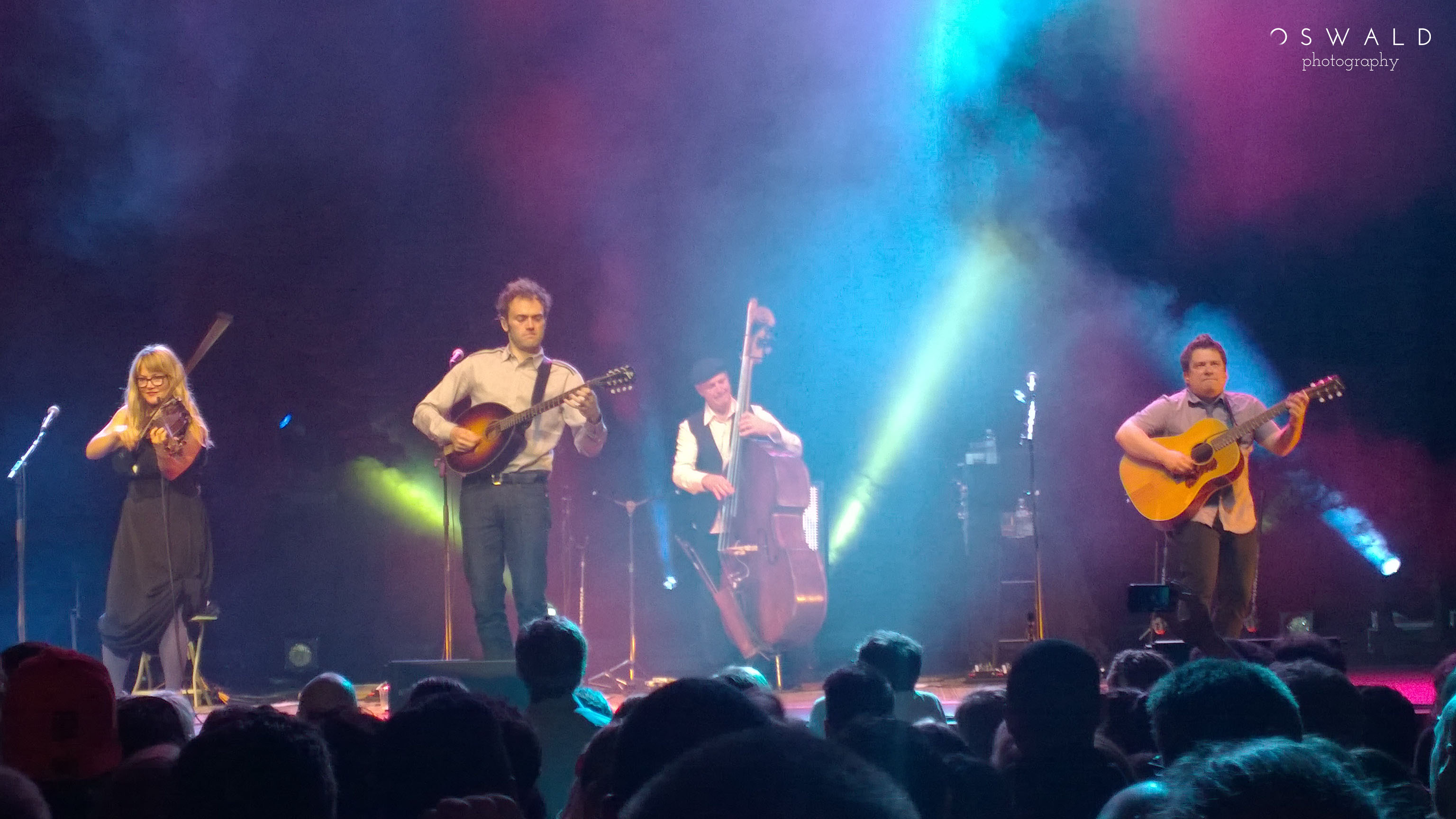 Photograph of the bluegrass band Nickel Creek on stage at the Fox Theater in Oakland, CA -- May 19, 2014