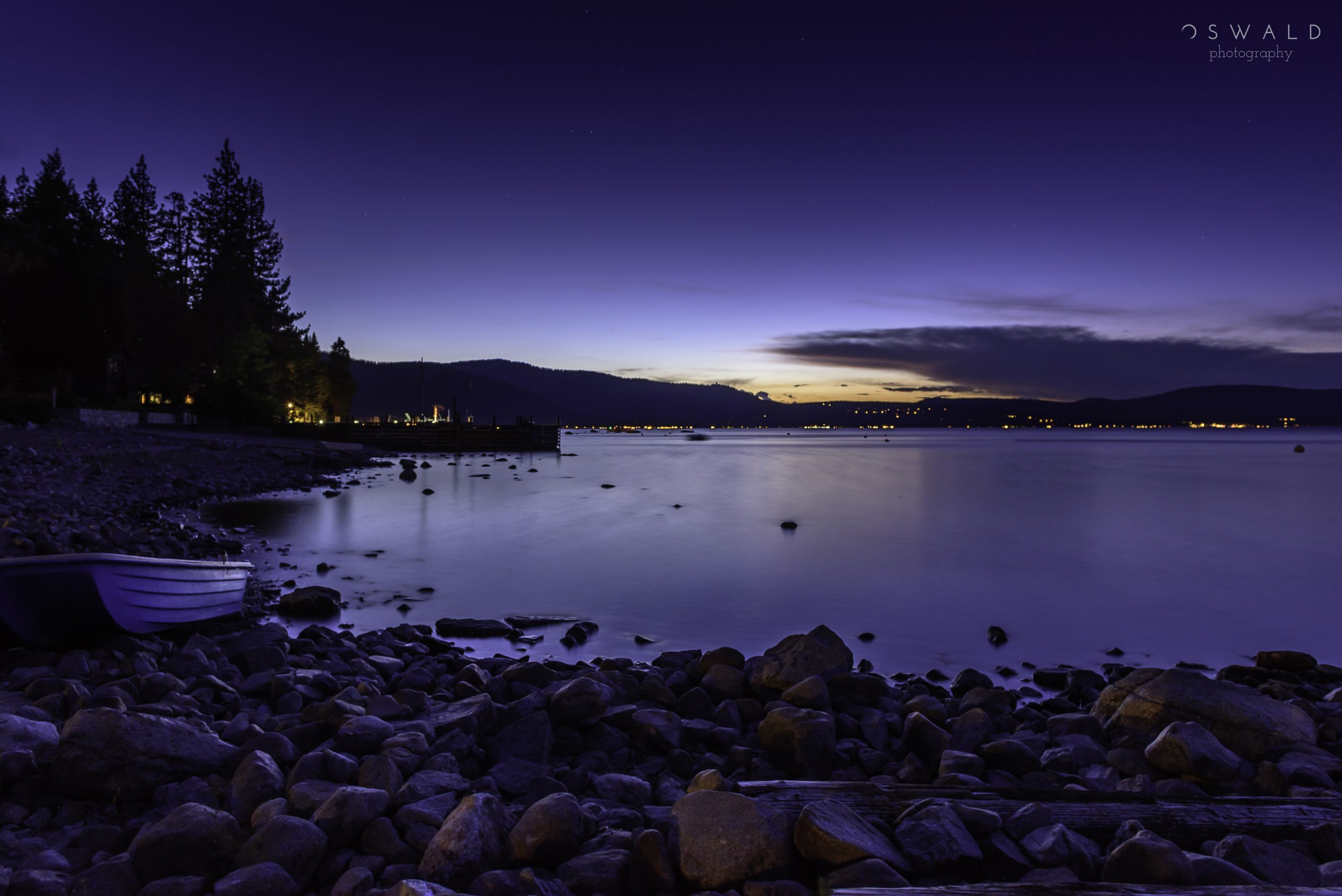 Long exposure nighttime photography upon the shores of North Lake Tahoe as the stars begin to shine.
