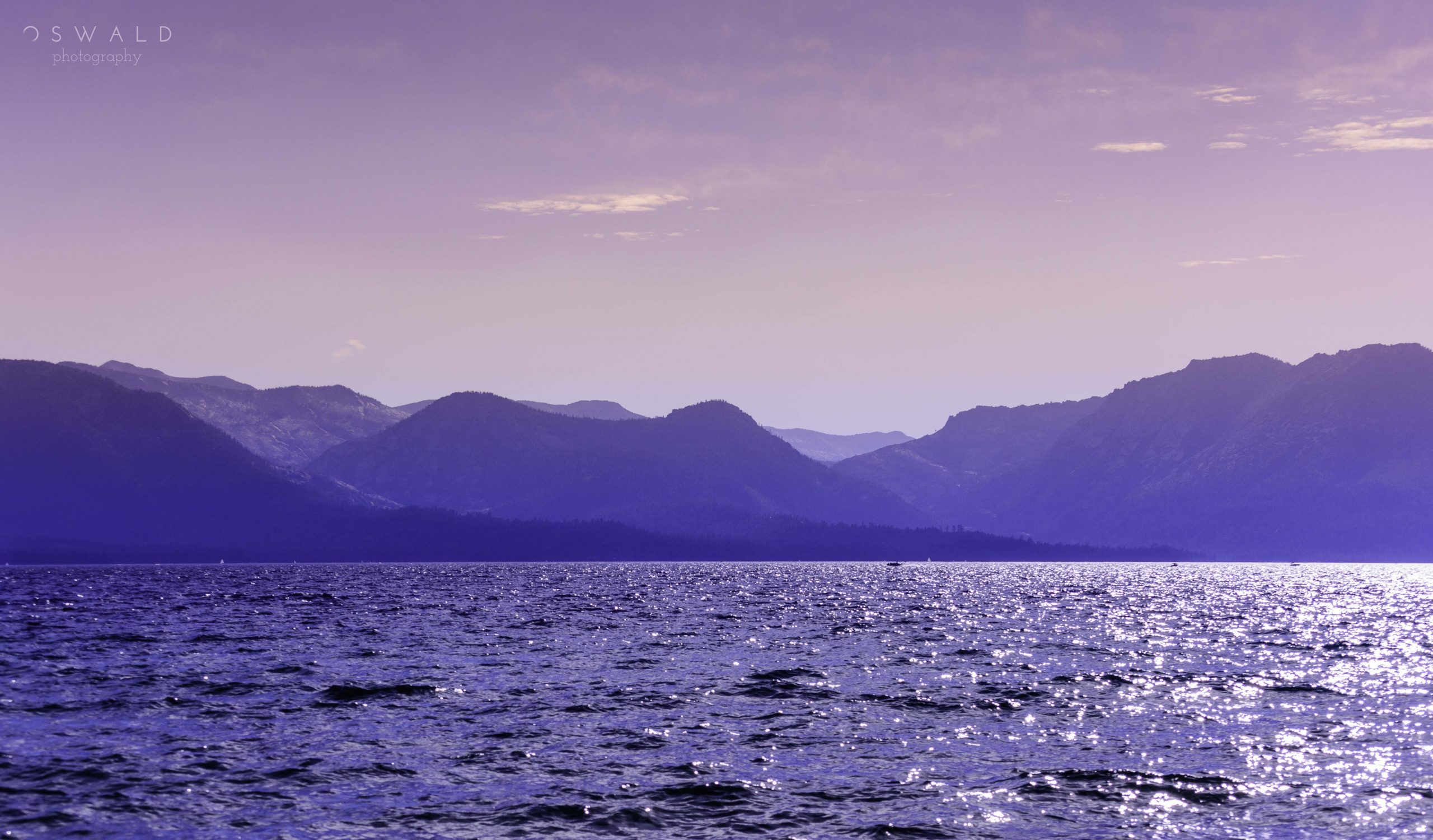 A landscape photograph of Scotland's Loch Ness as taken from a boat in the middle of the Loch,