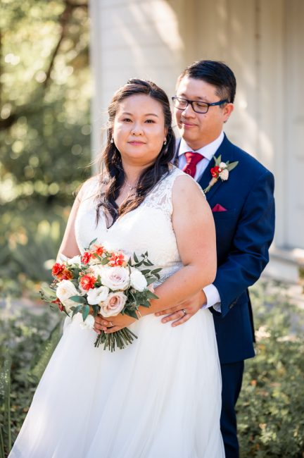 A bride and groom relax after an Ardenwood Histoic Farm Wedding