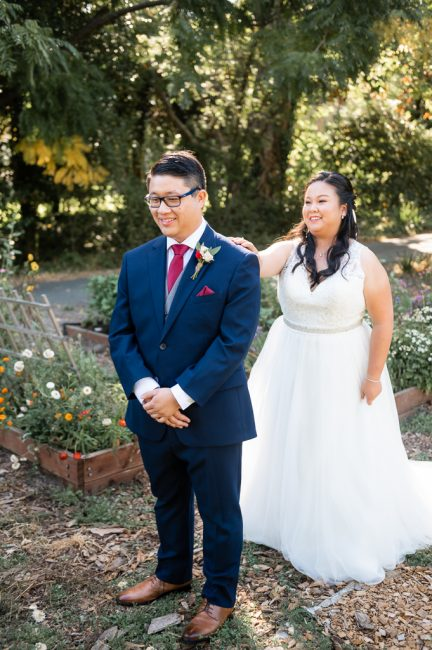 A first look in the gardens at an Ardenwood Historic Farm wedding