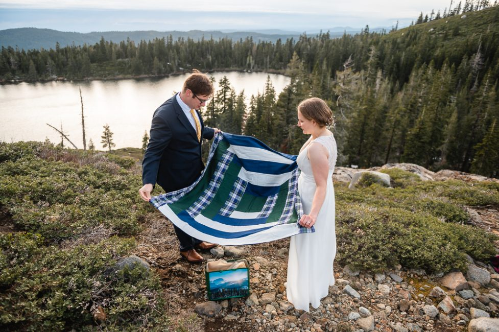 A couple exchanges gifts at their Carr and Feeley Lakes Elopement