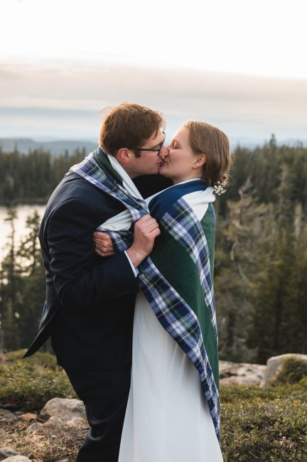 Newlyweds embrace during theirCarr and Feeley Lakes Elopement