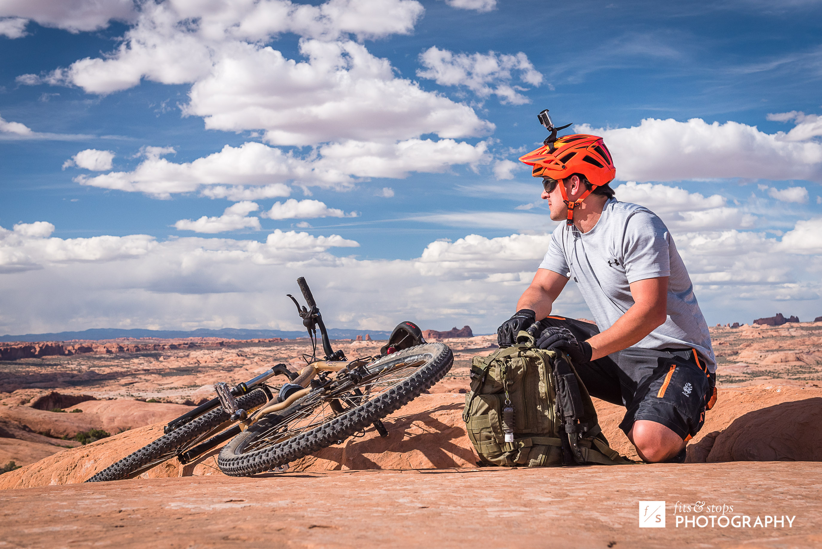 A young mountain bike rider looks out over the landscape at Slickrock Trail near Moab, Utah.