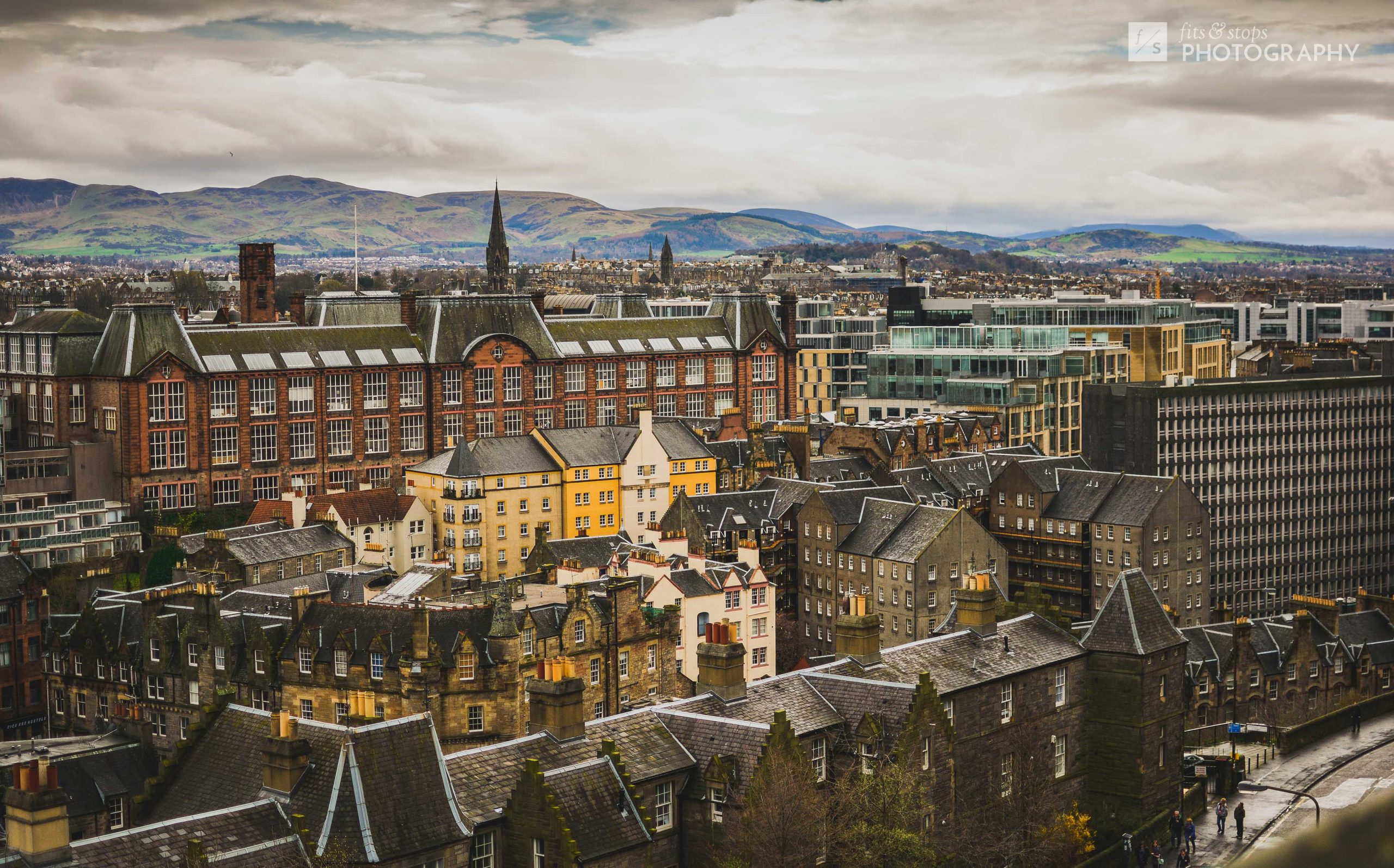 A landscape photograph of the rooftops of Edinburgh as taken from Edinburgh Castle in Scotland.