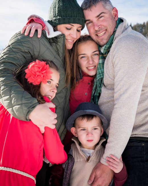 Close up family portrait in the snow