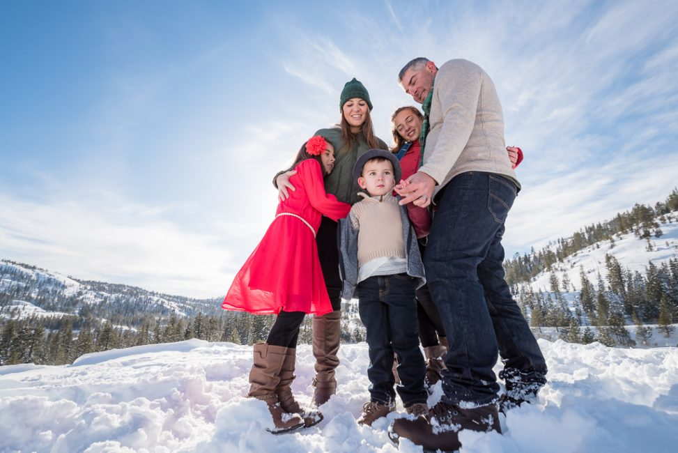 Wide angle family portrait in the snow