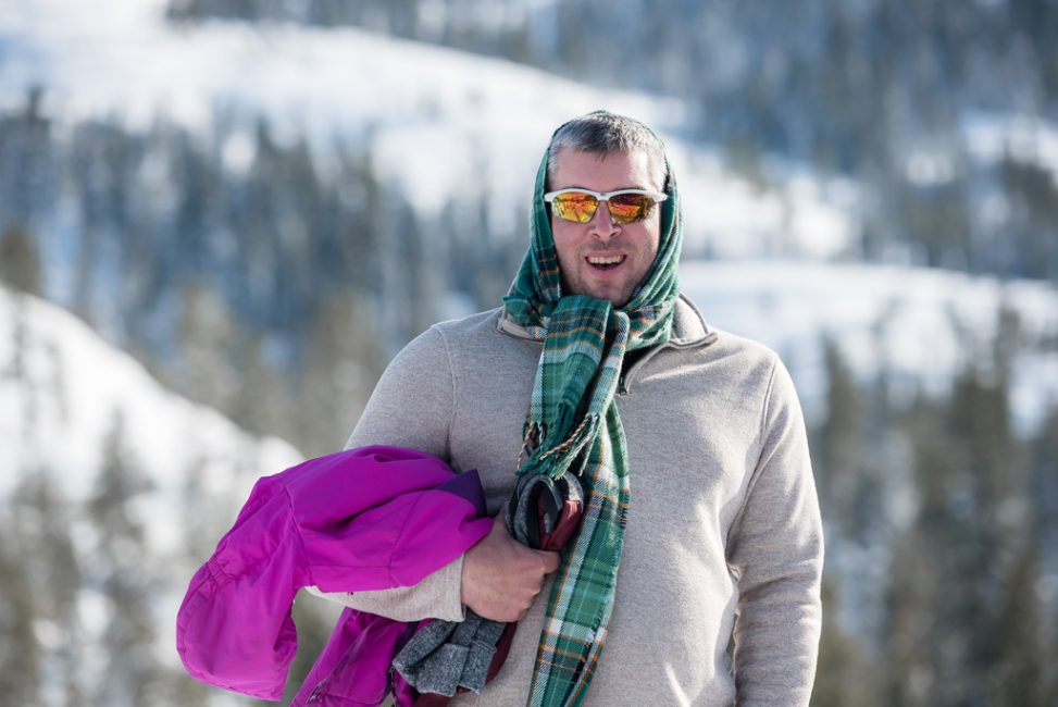Portrait of a father dressed up in his kids outdoor gear in the snow