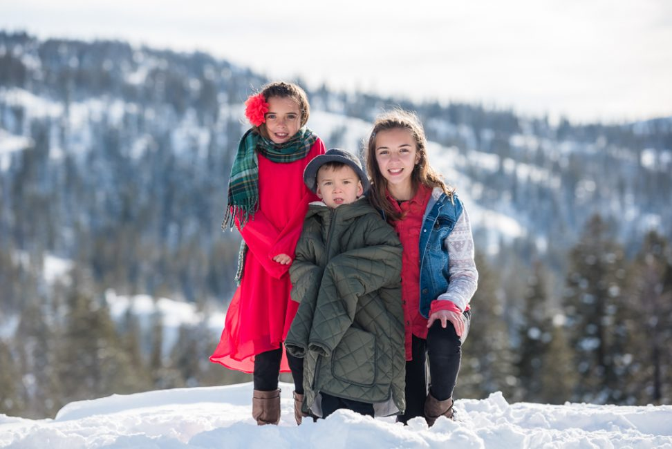 Siblings pose together for a chilly portrait in the snow