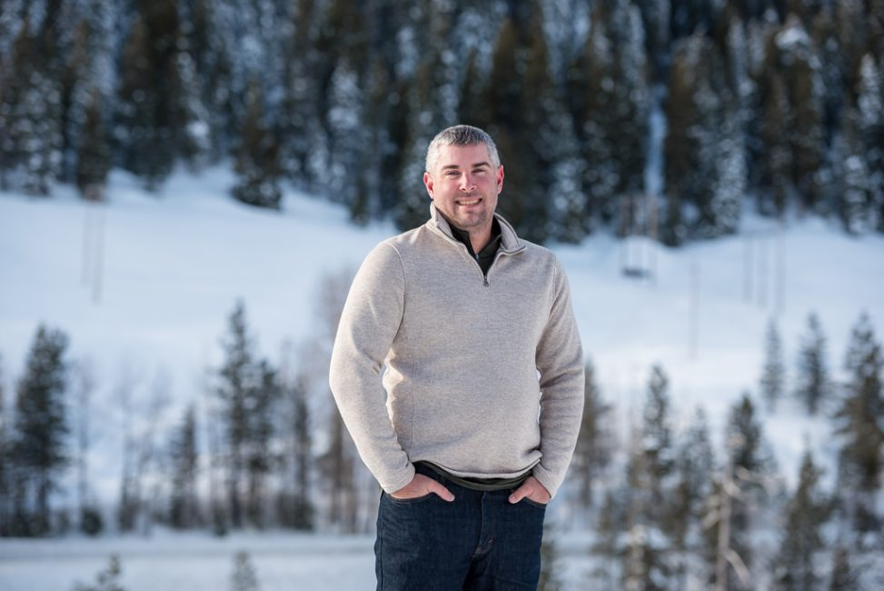 Portrait of a young man standing in the snow near Emmigrant Gap, CA