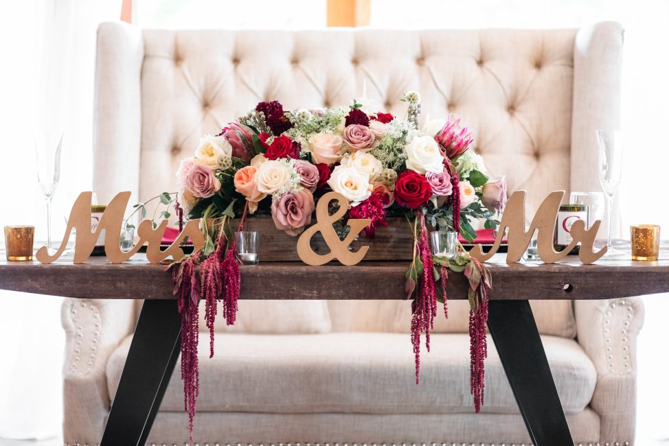 The sweetheart table at a Forest House Lodge Wedding