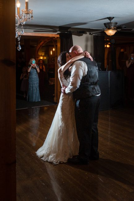 A bride and groom share their first married dance during their Forest House Lodge Wedding