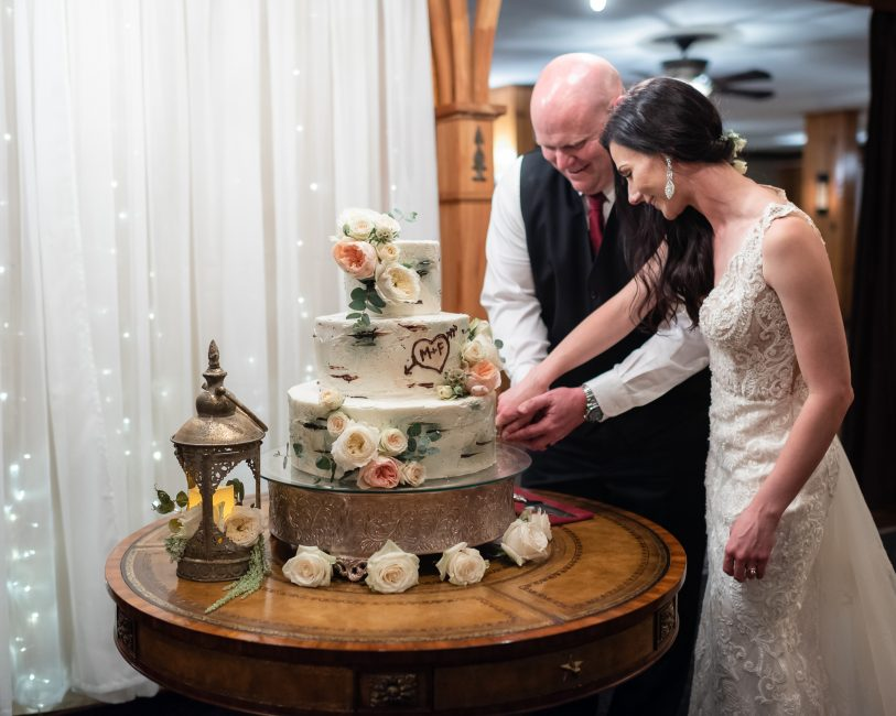 Cake cutting during the reception of a Forest House Lodge Wedding