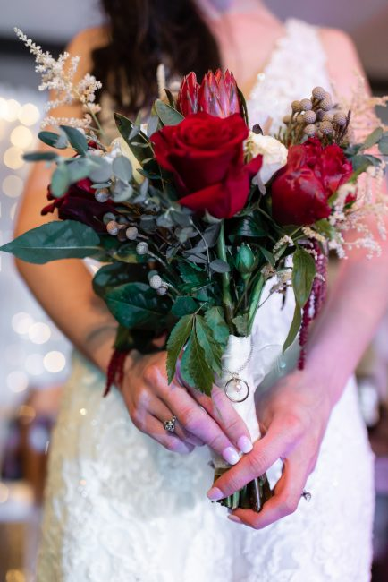 A bride clutches her bouquet at her Forest House Lodge wedding