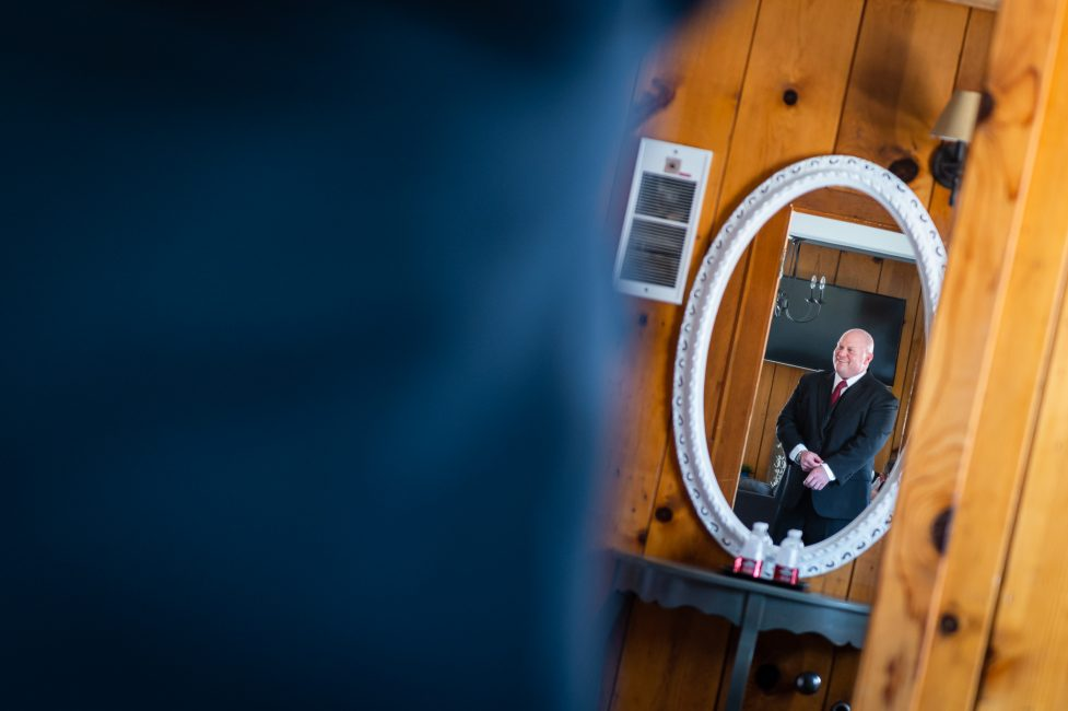 A groom gets ready for his Forest House Lodge wedding.