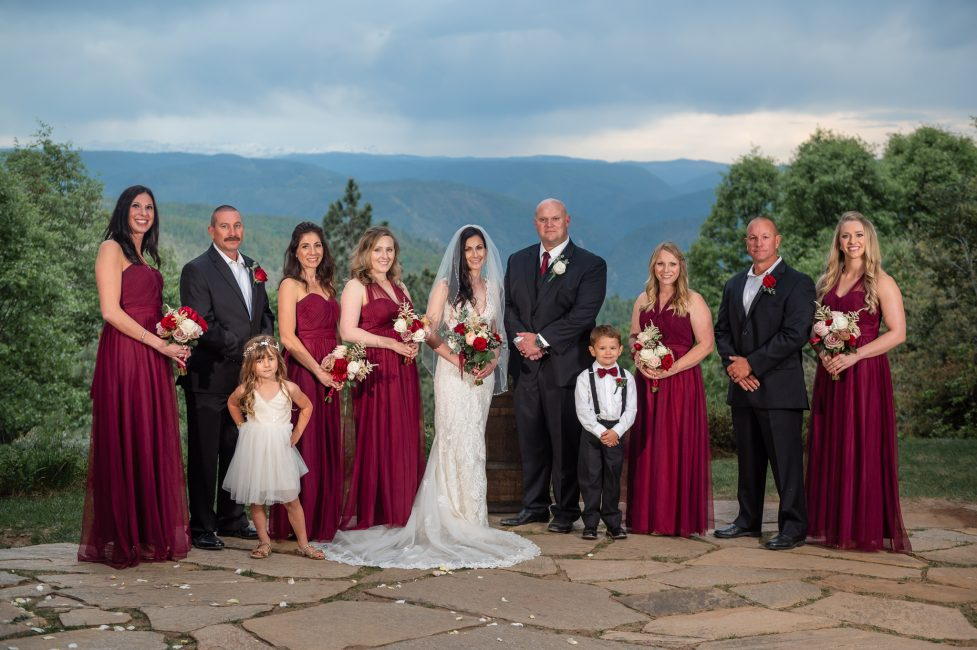 A family poses for a portrait at a Forest House Lodge Wedding