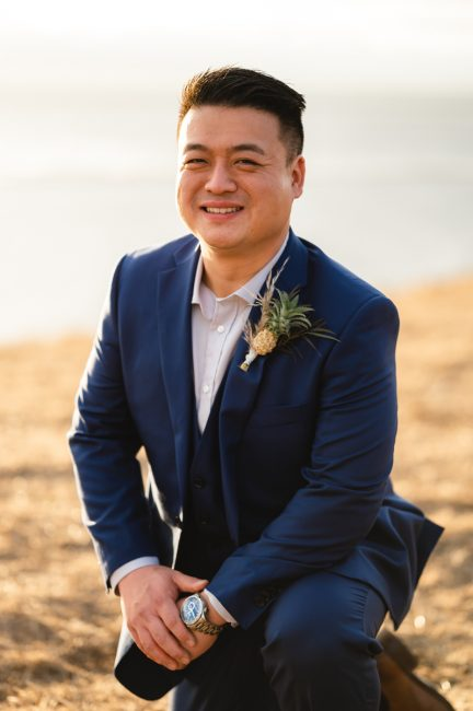 Portrait of a Korean groom captured on a hilltop in Coyote Hills Regional Park.