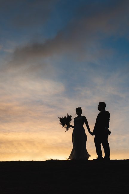 Silhouette of a newlywed couple at Coyote Hills Regional Park