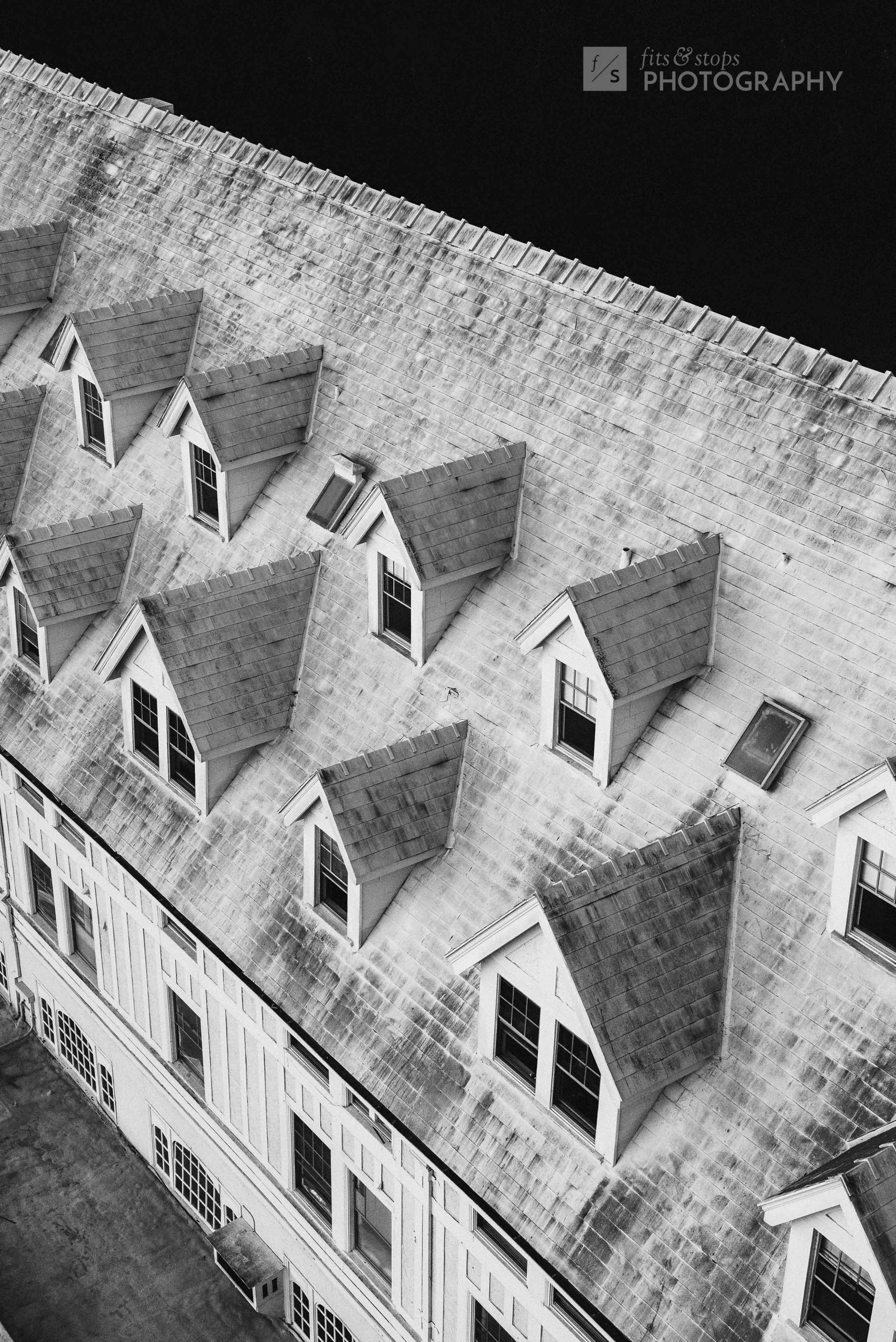 A high contrast black and white photo of the gables of Claremont Inn and Resort in Berkeley California, shot down from the tower