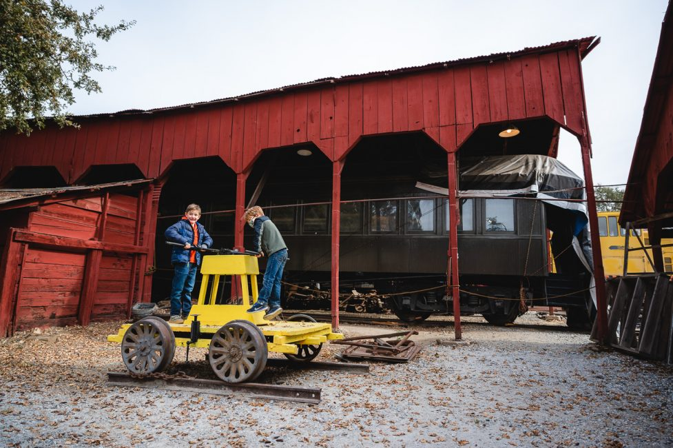 Two boys play on a pump rail car at Railtown 1897 State History Park in Jamestown, CA.