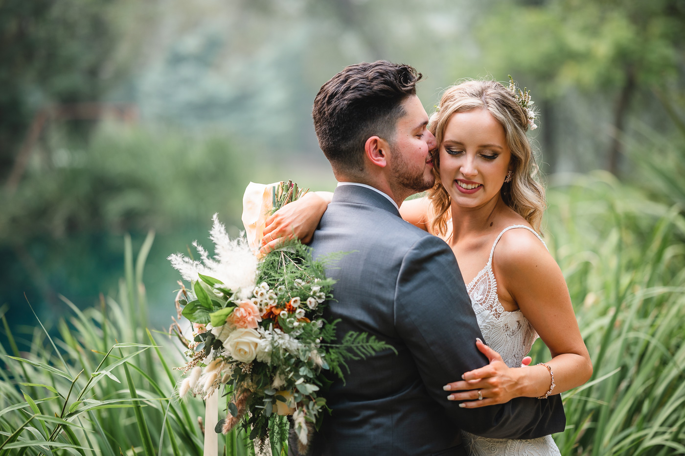 A newlywed couple embraces at a High Sierra Iris & Wedding Garden Wedding