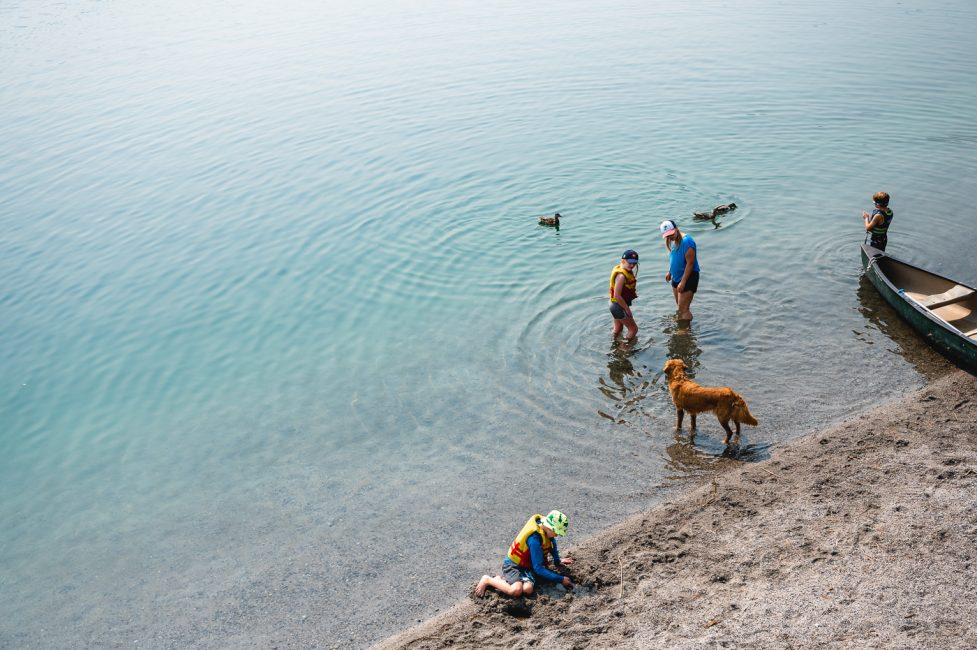 A family plays on the shores of June Lake in Mono County.
