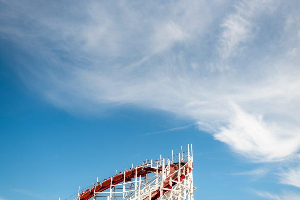 A wooden roller coaster beneath beautiful clouds at Santa Cruz Beach Boardwalk