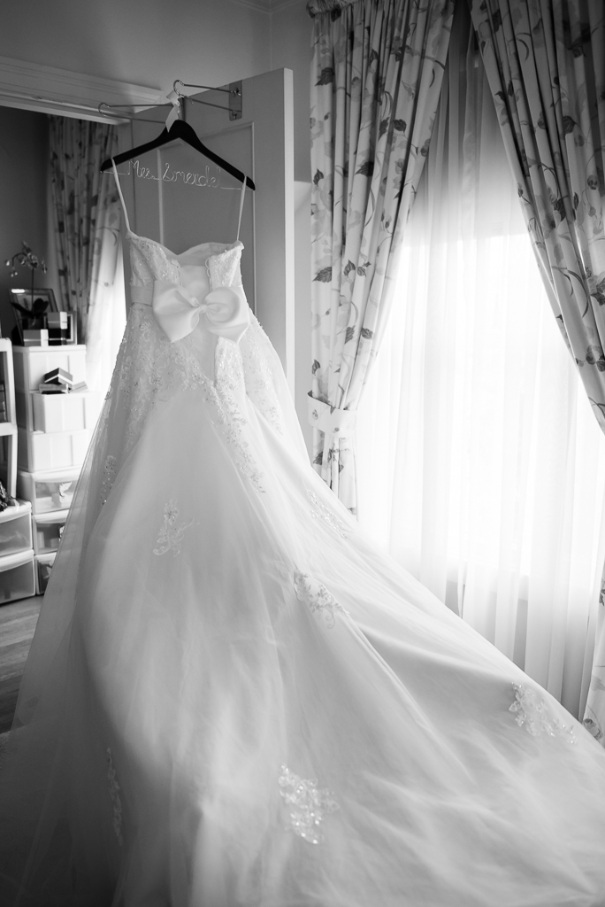 Black and white photo of a suspended wedding dress