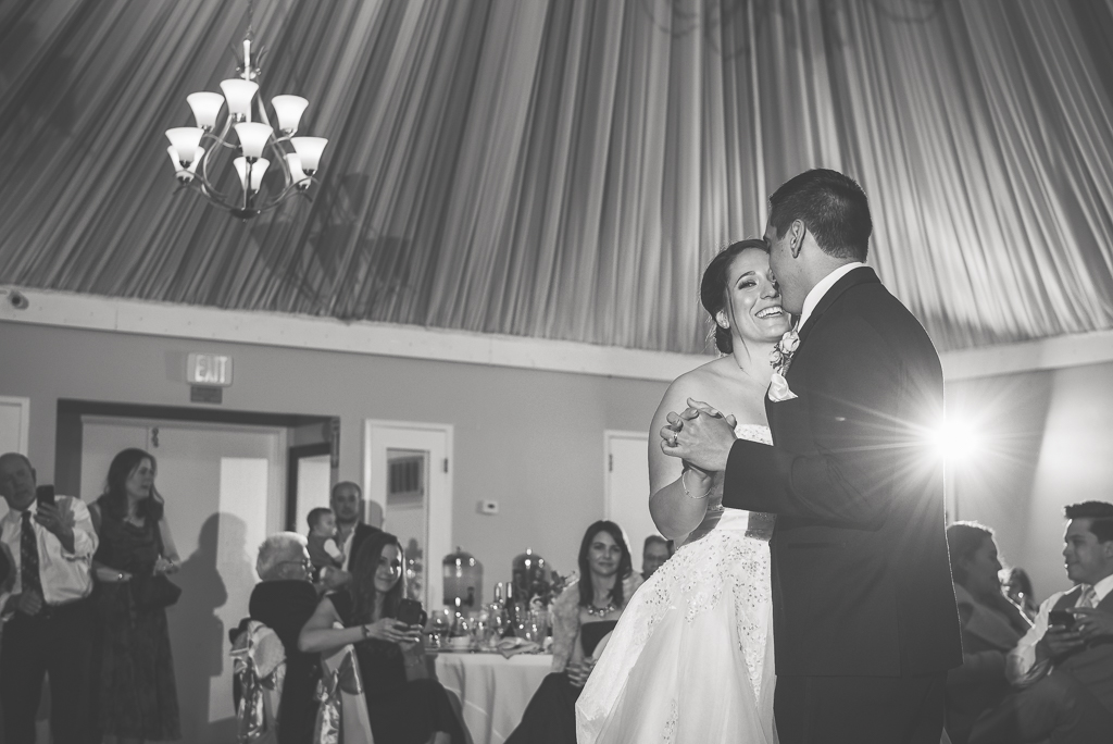 Black and white photo of a bride and groom dancing at Dominic's at Oyster Point.