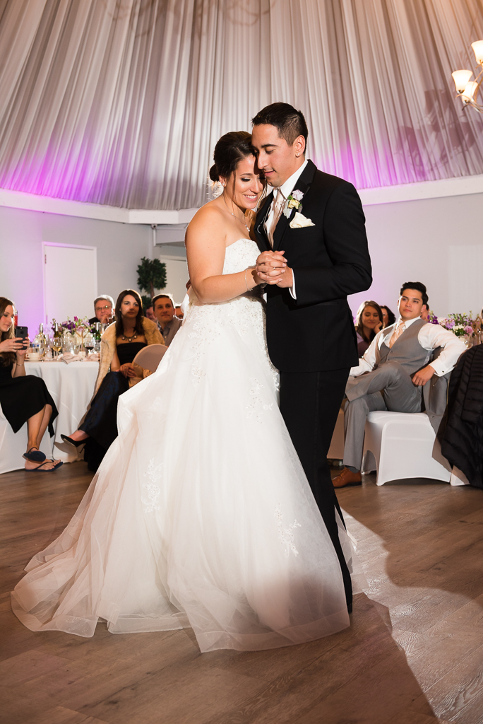 A bride and groom share their first dance as married couple.