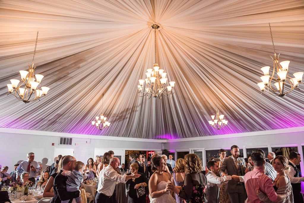 A full dance floor at a wedding reception at Dominics at Oyster Point.