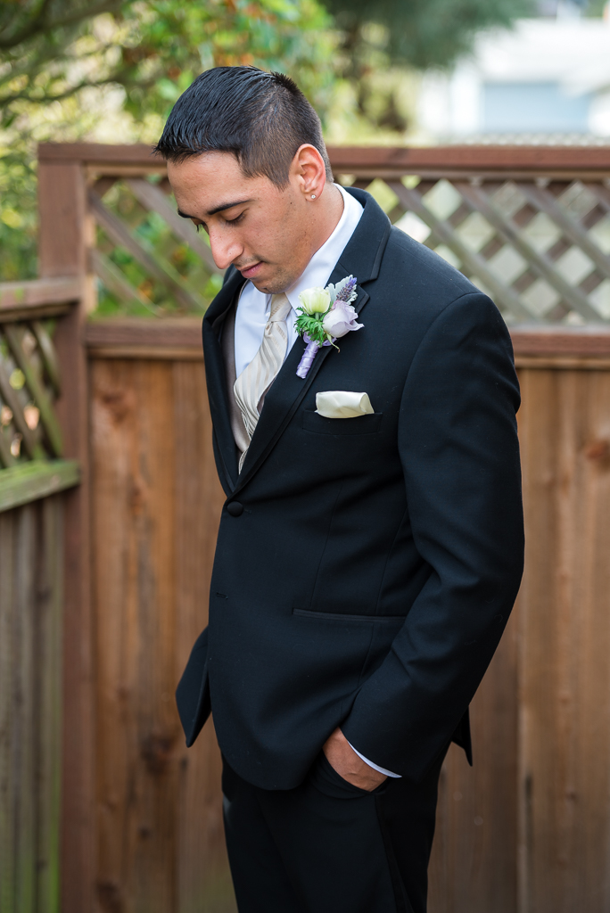 Moody photo of a young italian-american groom on his wedding day.