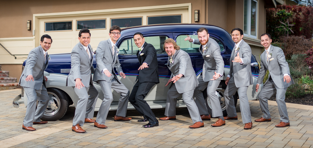 Photograph of a groom and groomsmen pretending to surf.