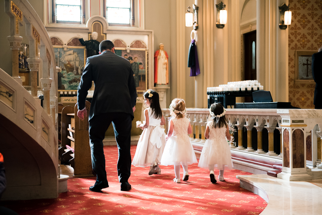 A trio of flowergirls finish the processional and exit, stage left.