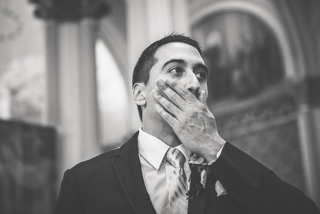 Black and white photo of a groom's first look at his bride on their wedding day.