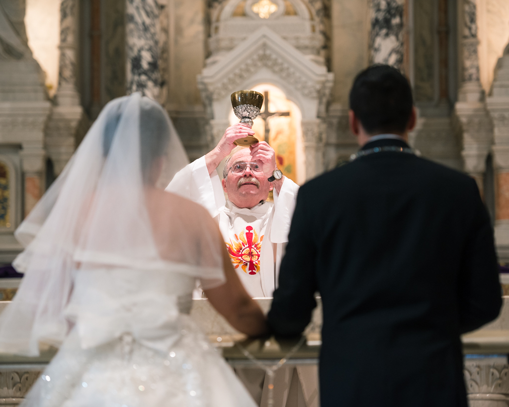 Photo of a catholic communion during a wedding