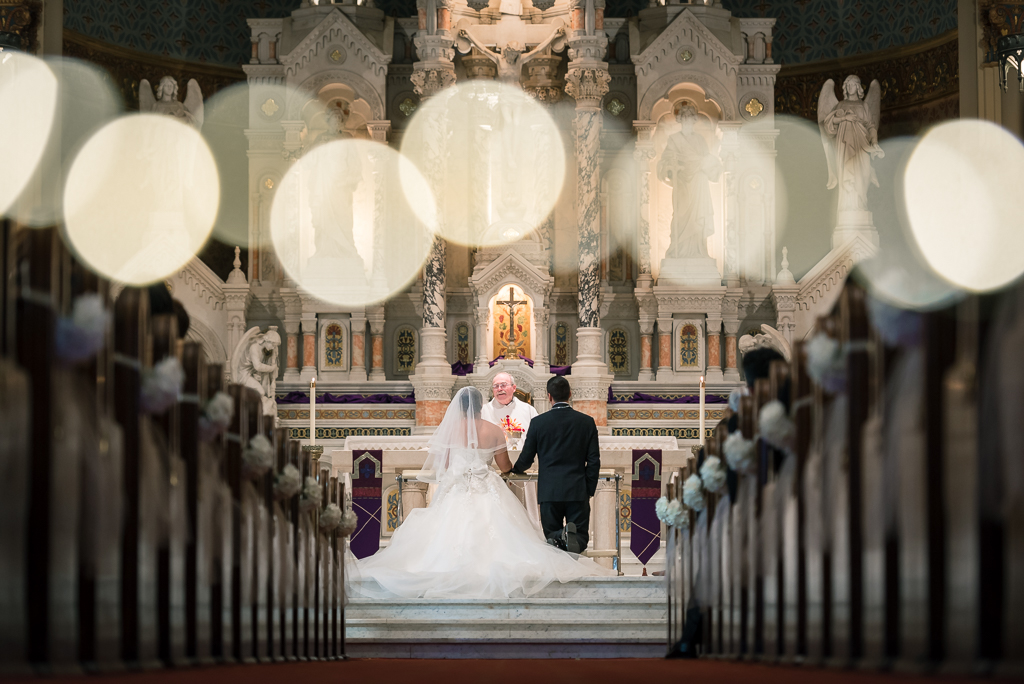 Photo of stringed lighting during a Catholic wedding ceremony.