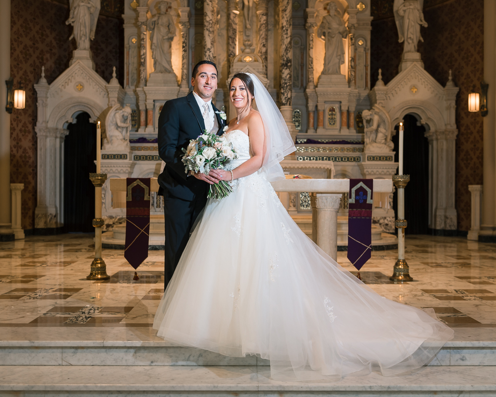 Formal wedding portrait taken at Saints Peter and Paul Church in San Francisco.