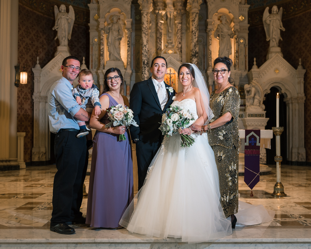 Family wedding portrait in a Catholic church.