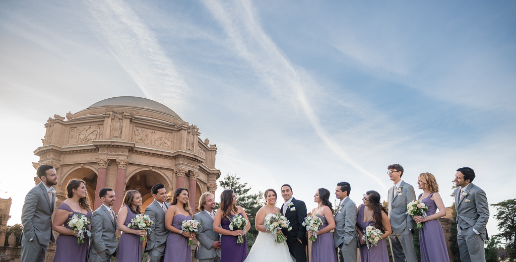 A bridal party portrait captured with the Palace of Fine Arts in the background
