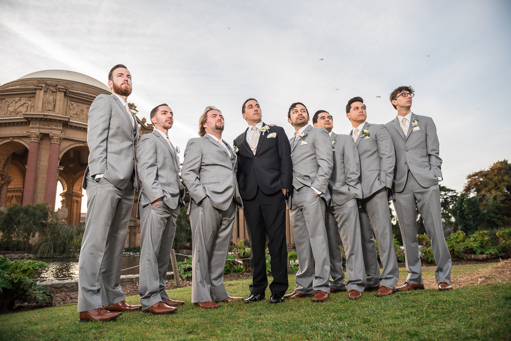 Imposing photo of groomsmen and a groom at the Palace of Fine Arts.
