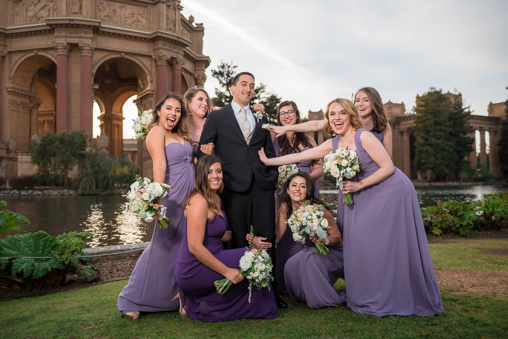 Photo of bridemaids fawning over the groom.